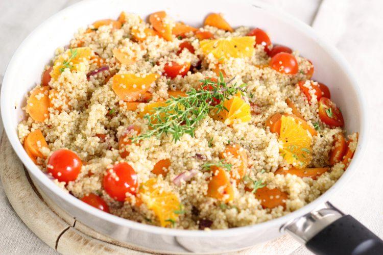 Healthy quinoa and vegetables in pan for vegan diet custom meal plan