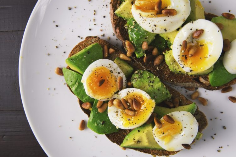 Healthy egg and avocado sandwich on a plate boosting High Energy Diet - Custom meal plan