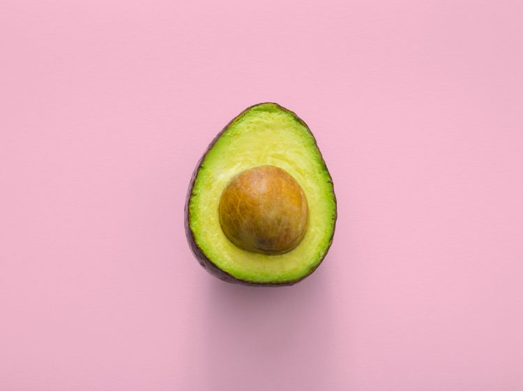 Avocado and pink background - gut healing diet