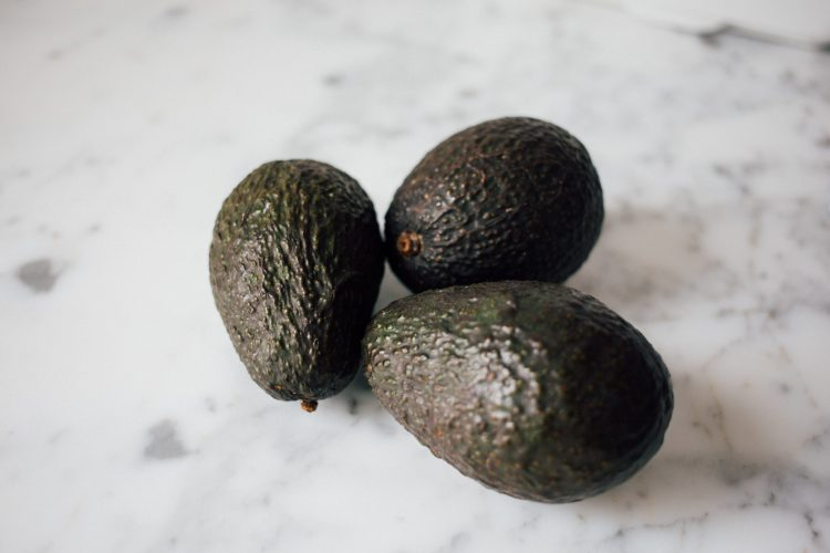 two avocados on a table - Low carb high protein diet custom meal plan