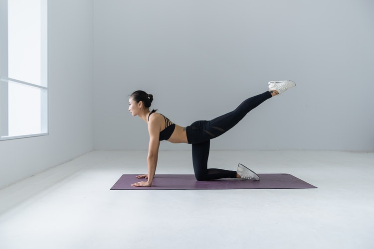 woman doing personal training class and working out at home